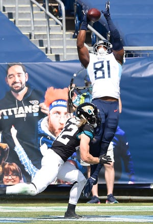 Titans tight end Jonnu Smith (81) hauls in a touchdown catch over Jaguars safety Andrew Wingard (42) during a September game in Nashville.