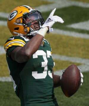 Green Bay Packers running back Aaron Jones scores a touchdown against the Detroit Lions on Sep. 20 at Lambeau Field.