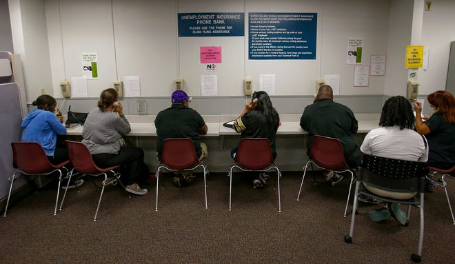 Visitors use the Unemployment Insurance phone bank at the California Employment Development Department, EDD office in Sacramento, Calif., in 2013.