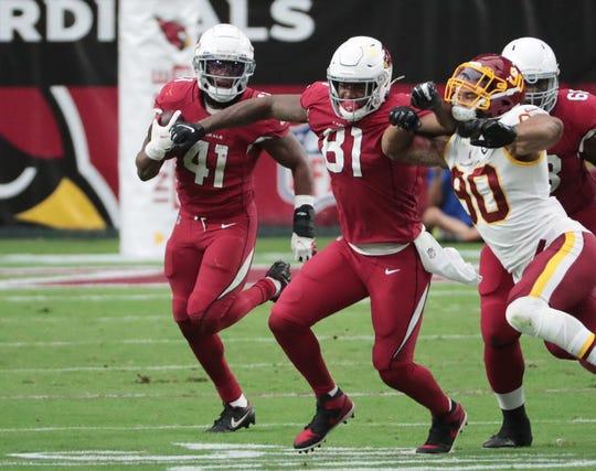 Arizona Cardinals running back Kenyan Drake (41) runs behind a block by tight end Darrell Daniels (81) on Washington Football Team defensive end Montez Sweat (90) during the fourth quarter at State Farm Stadium Sept. 20, 2020.