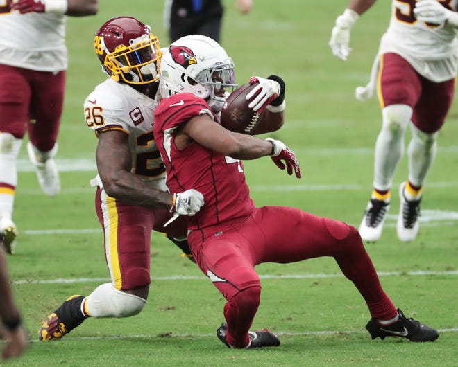 Arizona Cardinals running back Kenyan Drake (41) is brought down by Washington Football Team strong safety Landon Collins (26) on a run during the fourth quarter at State Farm Stadium Sept. 20, 2020.