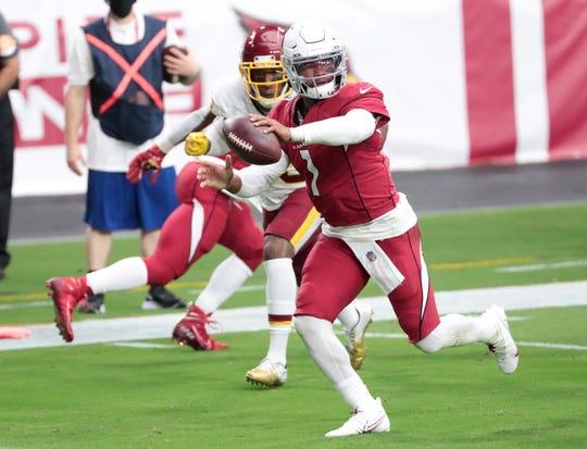 Arizona Cardinals quarterback Kyler Murray (1) scores a touchdown against the Washington Football Team during the first quarter at State Farm Stadium Sept. 20, 2020.