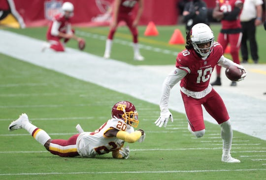 Arizona Cardinals wide receiver DeAndre Hopkins (10) breaks a tackle by Washington Football Team cornerback Jimmy Moreland (20) after a catch during the first quarter at State Farm Stadium Sept. 20, 2020.