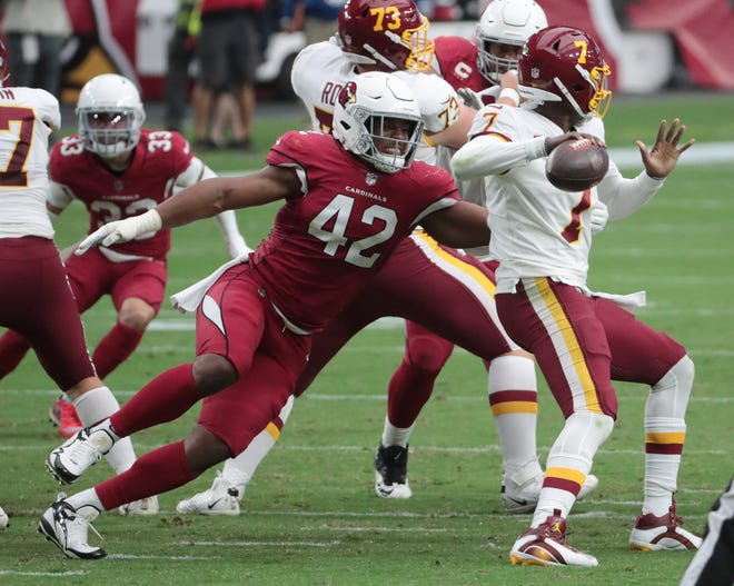 Arizona Cardinals outside linebacker Devon Kennard (42) puts pressure on Washington Football Team quarterback Dwayne Haskins (7) during the third quarter at State Farm Stadium Sept. 20, 2020.
