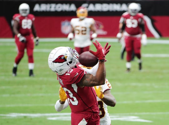 Arizona Cardinals wide receiver Christian Kirk (13) makes a catch while defended by Washington Football Team cornerback Ronald Darby (23) during the second quarter at State Farm Stadium Sept. 20, 2020.
