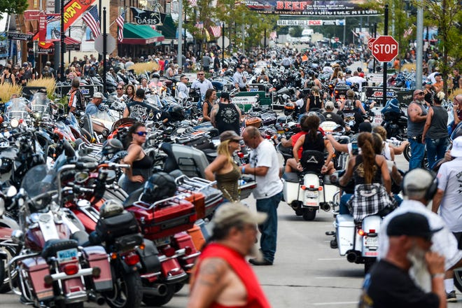 Motorcycles and people crowd Main Street during the 80th Annual Sturgis Motorcycle Rally in Sturgis, South Dakota, on August 7, 2020. (Michael Ciaglo/Getty Images/TNS)