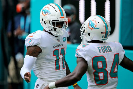 Sep 20, 2020; Miami Gardens, Florida, USA; Miami Dolphins wide receiver DeVante Parker (11) celebrates after scoring a touchdown against the Buffalo Bills during the first half at Hard Rock Stadium. Mandatory Credit: Jasen Vinlove-USA TODAY Sports