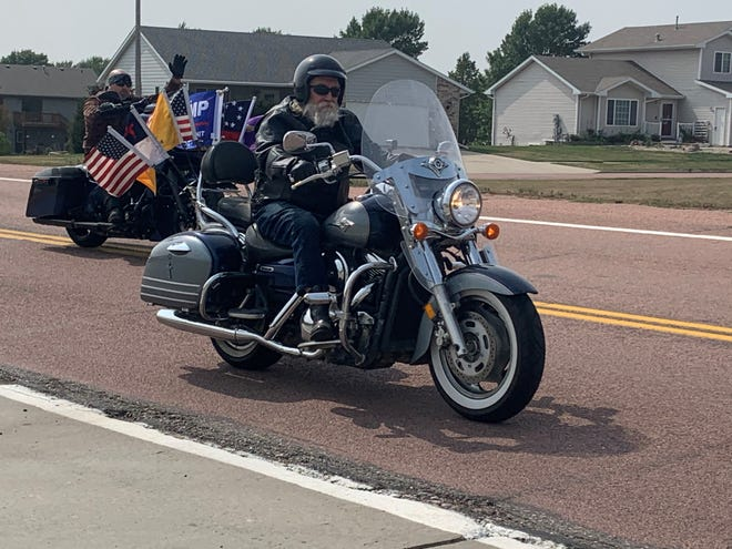 A biker makes his way through Dell Rapids during a rally in support of President Trump on Sunday, Sept. 20.