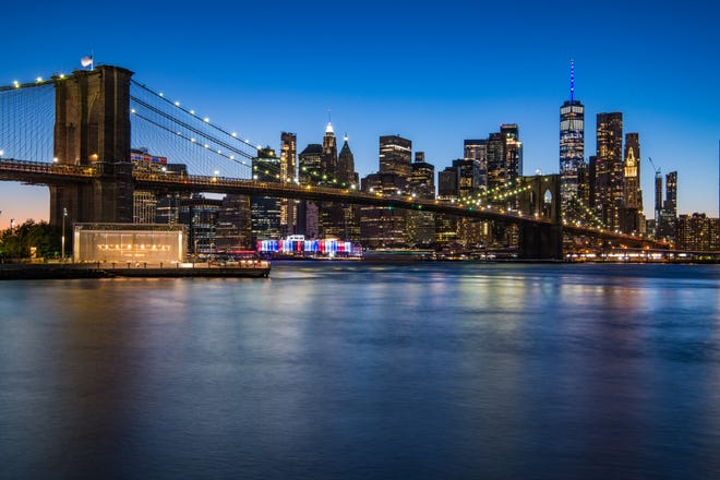 Landmarks across New York were lit blue Saturday, Sept. 19, 2020 in honor of the death of Ruth Bader Ginburg, the Brooklyn native who died a day earlier.