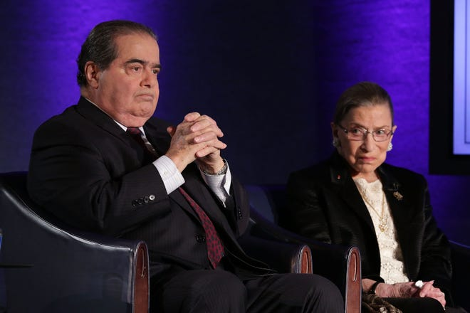 """Supreme Court Justices Antonin Scalia and Ruth Bader Ginsburg wait for the beginning of the taping of """"The Kalb Report"""" on April 17, 2014, at the National Press Club in Washington, D.C."""