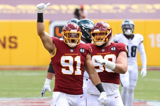 Washington Football Team defensive end Ryan Kerrigan (91) celebrates after a sack against the Philadelphia Eagles in the first quarter at FedEx Field.