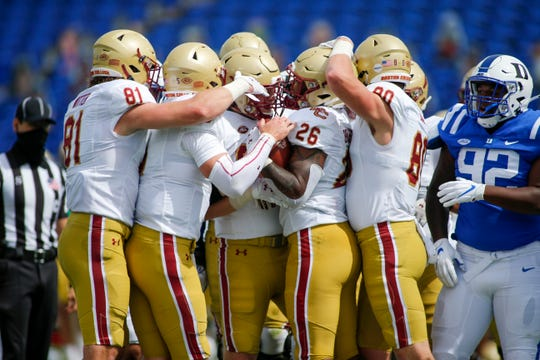 Boston College running back David Bailey (26) gets congratulations from his teammates after scoring a touchdown against Duke at Wallace Wade Stadium.
