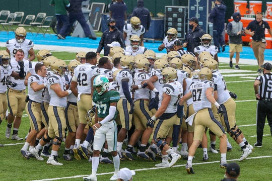 Navy Midshipmen celebrate after a game-winning kick against the Tulane Green Wave at Yulman Stadium in New Orleans.