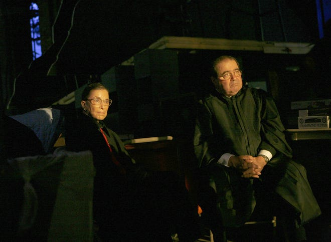 Supreme Court Justices Ruth Bader Ginsburg and Antonin Scalia watch an opera from the wings at the Kennedy Center, waiting for their turn to go on stage as supernumeraries during the Washington National Opera's 50th anniversary Golden Gala celebrations in April 2006.