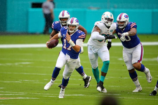 Buffalo Bills quarterback Josh Allen (17) runs with the ball against the Miami Dolphins during the first half at Hard Rock Stadium.