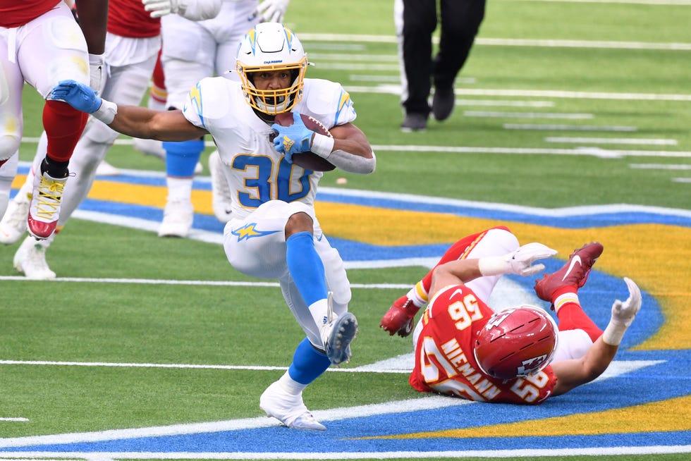 Los Angeles Chargers running back Austin Ekeler (30) breaks away from Kansas City Chiefs linebacker Ben Niemann (56) during the second quarter at SoFi Stadium.