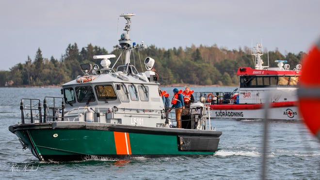 People are evacuated from the Amorella cruise ship near the Aland islands, seen from Finland, on Sept. 20, 2020. Finnish authorities say a Baltic Sea passenger ferry with nearly 300 people has run aground in the Aland Islands archipelago between Finland and Sweden without injuries.