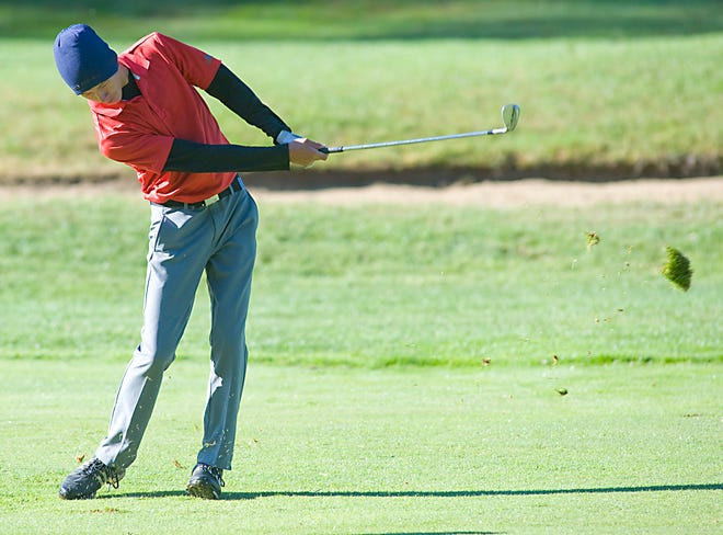 Alliance's Blake Hood hits an iron from the fairway during the Eastern Buckeye Conference tournament at Salem Country Club Monday, Sept. 21, 2020.