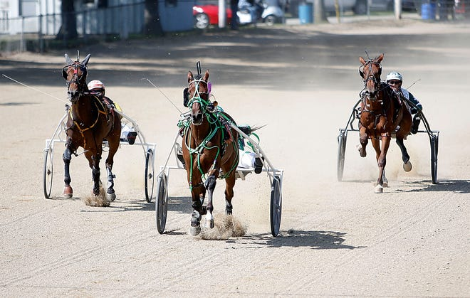 Harness racing takes place without any spectators or betting at the Ashland County Fair on Monday.
