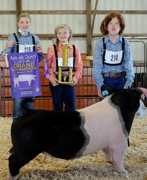 Brylyn Bryant, right, showed the grand champion market hog during the Junior Fair Market Hog Show on Monday at the Ashland County Fair.
