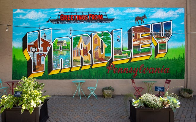 """Decorating the side of Firehouse Cycle, on Main street in Yardley, is this """"Greetings from Yardley, Pennsylvania"""" signage on Sept. 21."""