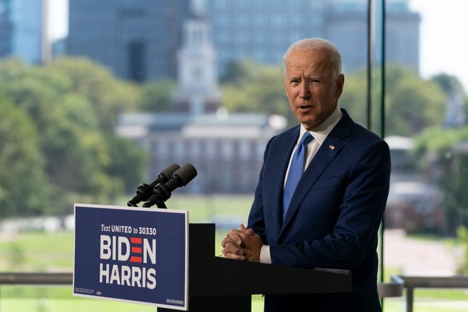 Independence Hall is seen in the distance as Democratic presidential candidate and former Vice President Joe Biden speaks at the Constitution Center in Philadelphia, Sunday, Sept. 20, 2020, about the Supreme Court.