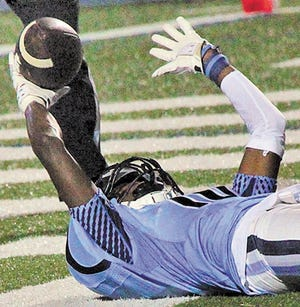 Former Bartlesville High School receiver A.J. Parker celebrates a touchdown catch, during the 2015 season, while on his back. Parker is in his third year as a starting defensive back at Kansas State.