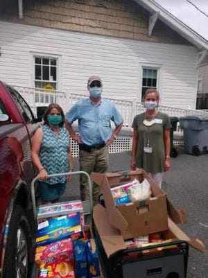 Randolph Rotary's service project for August was a food drive for BackPack Pals. Bill Keller and Aundrea Azelton of Randolph Rotary delivered supplies to Communities in Schools for BackPack Pals. Pictured left to right are Paula Owens, director of Communities in Schools; Bill Keller, president of Randolph Rotary; and Beth Allen with Communities in Schools.