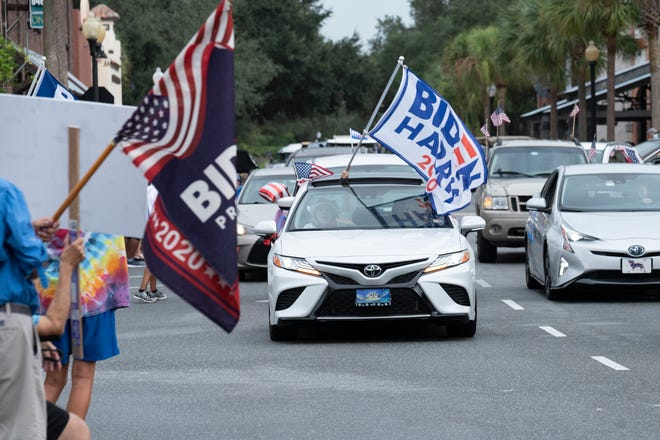 Cars drive in the Ridin' with Biden parade at the Spanish Springs Square in The Villages on Sunday. [Cindy Peterson/Correspondent]