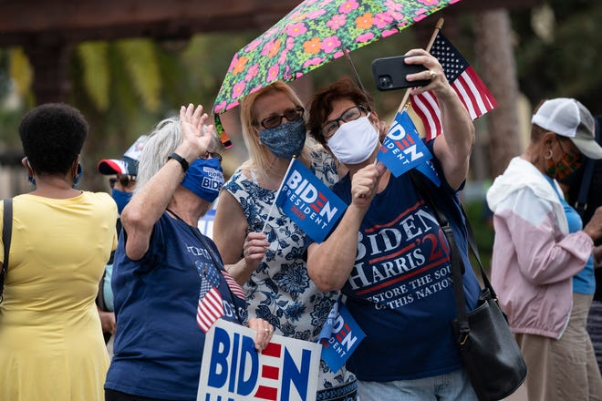 People take a photo during the Ridin' with Biden parade at the Spanish Springs Square in The Villages on Sunday, Sept. 20. [Cindy Peterson/Correspondent]