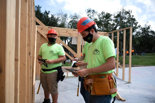 Students from the Leesburg High School Construction Academy work on constructing a home for Habitat for Humanity in Leesburg. [Cindy Peterson/Correspondent]