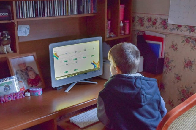 Zackery Bumgardner works on his schoolwork for his sixth grade year. He would have been starting middle school this year, but due to the pandemic his family have decided to utilize virtual options.