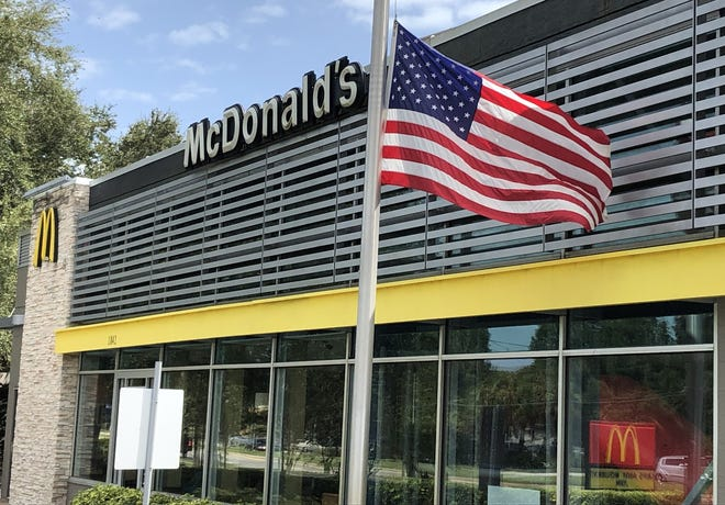Following the death of Supreme Court Justice Ruth Bader Ginsburg, a flag flies at half staff on Monday, Sept. 21, 2020, in front of a McDonald's restaurant in New Smyrna Beach, Florida. Mark Harper/USA TODAY Network]