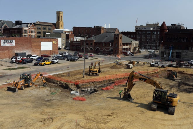 Work continues on a new parking lot on 5th and Valley Streets Monday in downtown Burlington. The city will pay $550,000 to build the parking lot which will then provide spaces rented out to two housing developments. The spaces will be rented to the Blaul Lofts and the Churchhill Lofts for use by the residents. The spaces in the new parking lot are to be rented out for $40 per space per month, which will bring in about $42,000 per year once the spaces are rented.