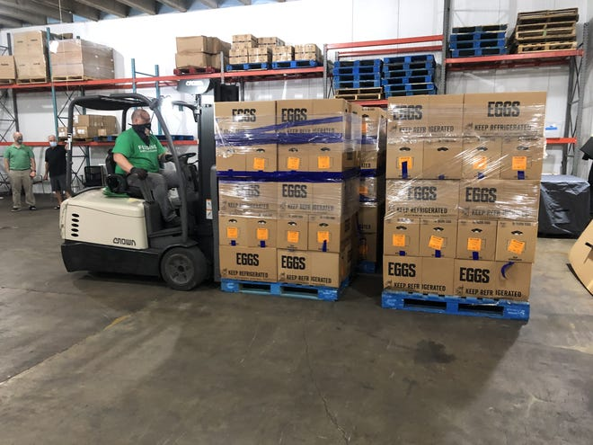 Boxes of eggs donated by Cowford Chophouse and Cal-Maine Foods are delivered Friday to a Feeding Northeast Florida warehouse.
