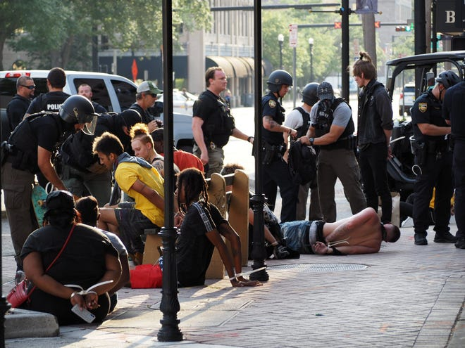 Jacksonville police detain and arrest several Black Lives Matter protesters shortly before 7 p.m. on May 31 at Bay and Market streets downtown. The governor announced Monday a legislative package to create additional criminal offenses involved in protests.