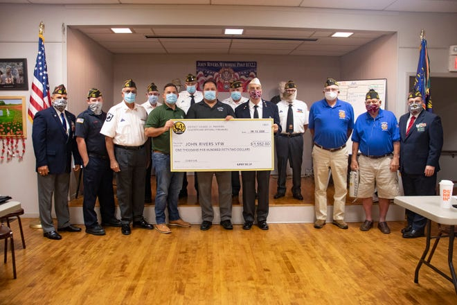 Members of IUPAT District Council 21 local unions representing painters, glaziers and drywall finishers presented a $1,552 donation to members of John Rivers Memorial Veterans of Foreign Wars Post 11322 in Quakertown during a recent meeting held at the VFW post. The funds were raised to help local veterans recoup fundraising efforts suspended due to the pandemic.