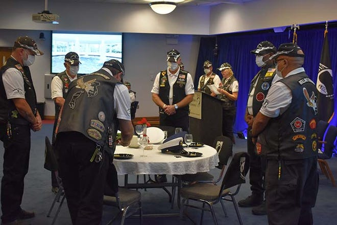"""Rolling Thunder, Chapter 5 NC recently held its POW/MIA Recognition Day ceremony at the Jacksonville City Hall. Pictured is their """"Missing Man"""" table ceremony in honor of fallen, missing, or imprisoned military service members. [Contributed photo]"""