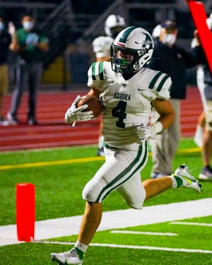 Aurora running back Evan McVay strides into the end zone during the Greenmen's win at Tallmadge Sept. 11.