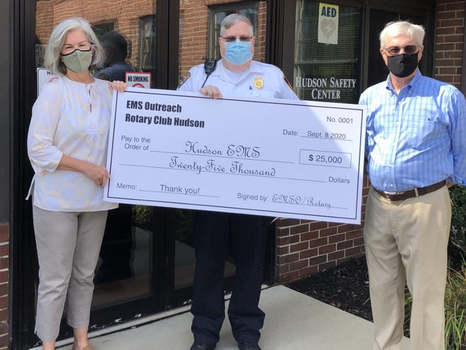 From left, Heidi Schweighoefer, President EMS Outreach of Hudson, Chief Jerry Varnes and Doug McDowell, of the Rotary Club of Hudson.