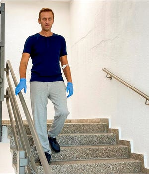 In this photo taken from a video published by Russian opposition leader Alexei Navalny on his instagram account, Russian opposition leader Alexei Navalny walks down stairs in a hospital in Berlin, Germany, on Saturday. Navalny, who is being treated in a German hospital for suspected poisoning by a nerve agent, says on social media that he is recovering verbal and physical abilities despite despairing at first.