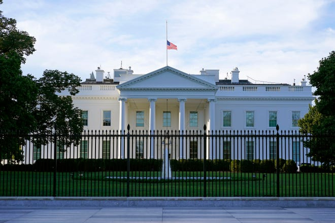 An American flag flies at half-staff over the White House in Washington on Saturday.  Federal officials intercepted an envelope addressed to the White House that contained the poison ricin.