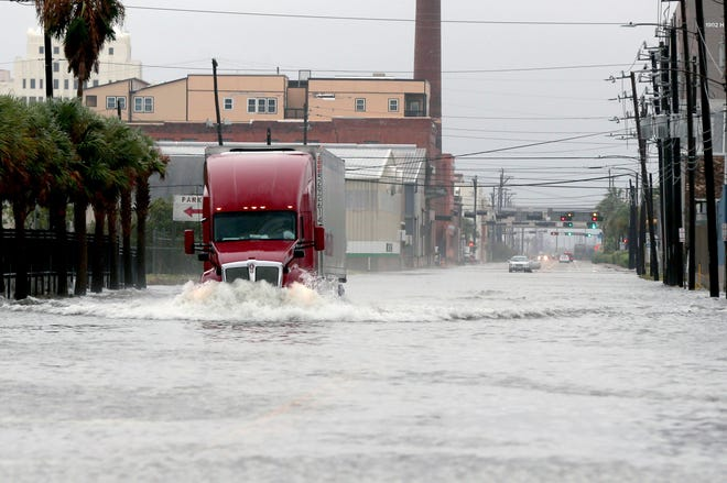A truck drives through a flooded street in Galveston, Texas on Monday. Parts of Texas and Louisiana braced for more flooding and damaging storm surge as Tropical Storm Beta slowly worked its way into a part of the country that's already been drenched and battered during this year's exceptionally busy hurricane season.