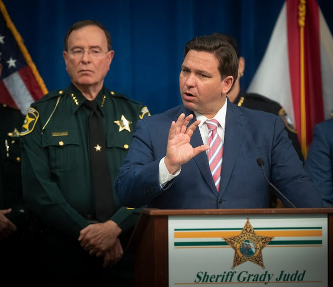 Florida Gov. Ron DeSantis, right, flanked by Polk County Sheriff Grady Judd, speaks to the media during a press conference at the PCSO Operations Center in Winter Haven on Monday. DeSantis unveiled a plan to deal with violent, disorderly protesters.