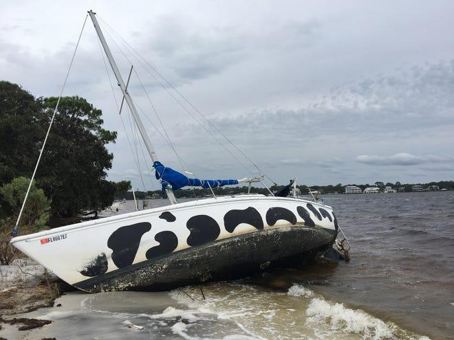 Hurricane Sally left this sailboat along the shore at Veterans Park on Okaloosa Island.