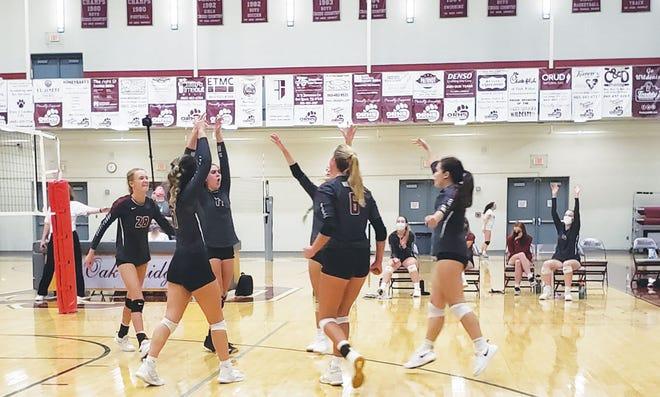 The Oak Ridge High School Lady Wildcats volleyball team celebrating