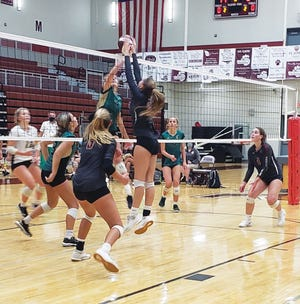 The Oak Ridge High School Lady Wildcats volleyball team in action.