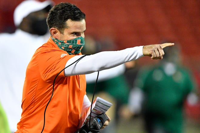 Miami Hurricanes head coach Manny Diaz reacts after a touchdown during the second half at Louisville.