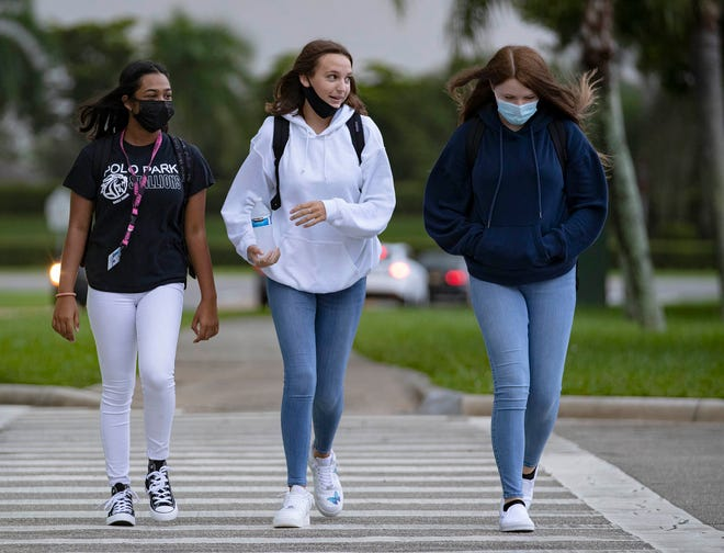 Students return to school at Polo Park Middle school on the first day of brick and mortar schooling following the COVID-19 pandemic Monday in Wellington. [ALLEN EYESTONE/palmbeachpost.com]