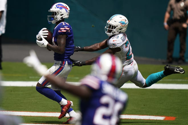 Bills receiver Stefon Diggs scores a touchdown as Dolphins cornerback Noah Igbinoghene tries to defend in Buffalo's 31-28 win in September.